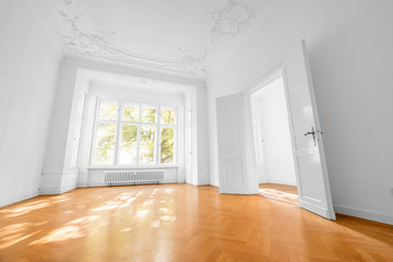 empty room in old apartment building with wooden parquet floor