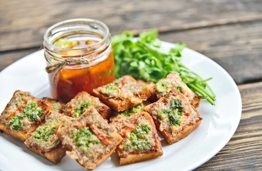 Fried toasts with Minced Pork Spread with chili sauce (Thai Pork Toast) . Toasts Menu for children.