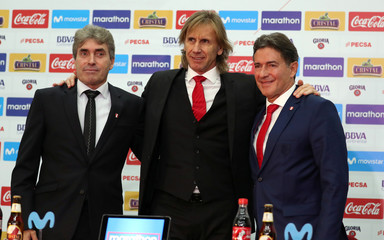 Peru's soccer coach Ricardo Gareca poses for a photo with Nestor Bonillo and Sergio Satin members of his technical team in Lima