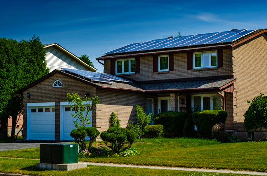 Three quarter view of an urban house with solar panels