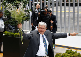 Mexican President-elect Andres Manuel Lopez Obrador gestures after formally being installed as the country's next president, outside the headquarters of the electoral authority, in Mexico City