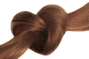 Brown hair knot in shape of heart, isolated on white background Wall mural