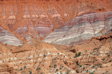 Colorful strata in the cliffs of Grand Staircase-Escalante National Monument in Paria, Utah of red, purple, gray, green, and blue in Grand Staircase-Escalante National Monument in Paria, Utah