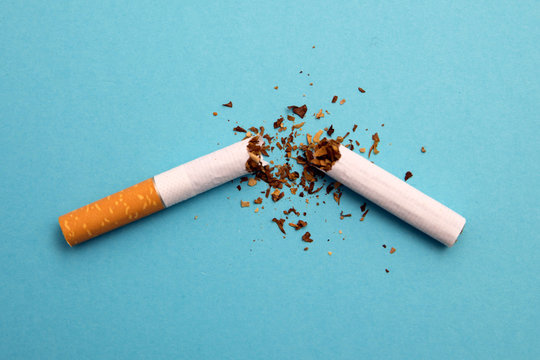 broken cigarette on a blue background