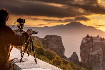 Man take photo from Meteora monastery