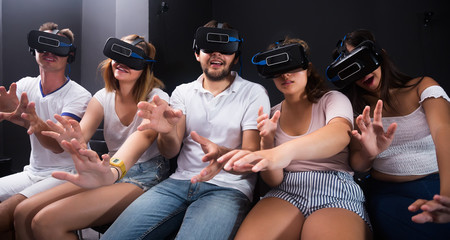 woman and  man using virtual reality glasses