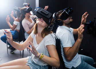 men and women try virtual reality in the 3d glasses