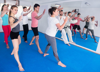 Young adult trainees practicing in karate class