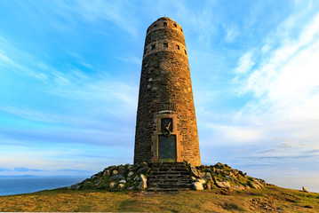 American Monument on island Islay, Soctland, at sunset