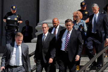 U.S. Rep. Christopher Collins (R-NY) (2nd L) departs the Thurgood Marshall United States Courthouse following his arraignment on insider trading charges in New York