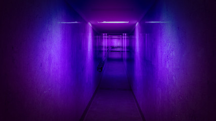 Tunnel, a long corridor at the end of which is light. Basement with illuminated walls. Neon