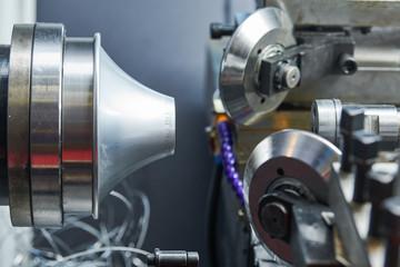 Sheet metal forming processes. spinning blank on cnc lathe machine