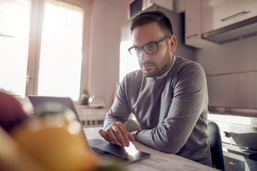 Young businessman working indoors