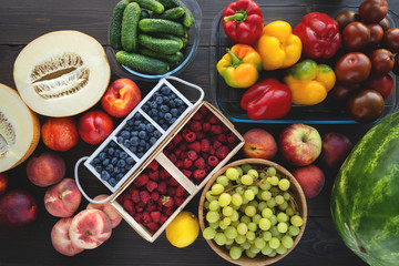Fresh vegetables and fruits from market on the gray background. Summer and healthy life concept.