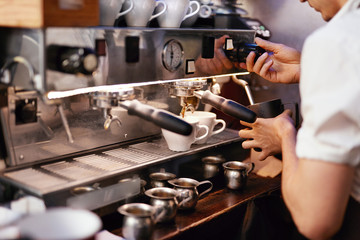 Preparing Drink In Coffee Machine By Barista At Cafe
