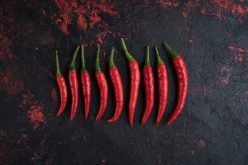Red hot chili peppers on old wooden table with place for text