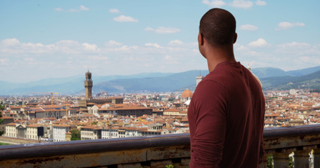 Tuinposter Florence Black male tourist traveling in Italy admiring Florence cityscape