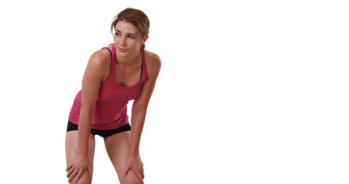 Portrait of slim sporty white female athlete resting on white background