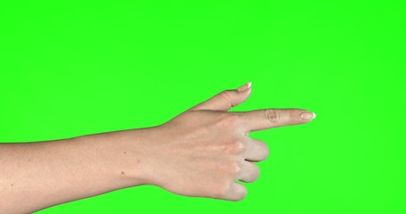 Female hand gestures on green screen: pointing