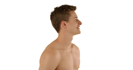 Profile view of handsome Caucasian male looking out at imaginary ocean in studio