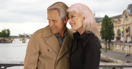 Portrait of mature couple enjoying retirement in Paris