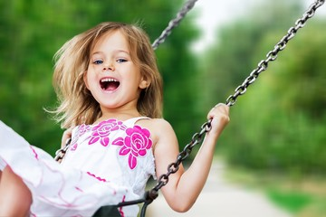 Little child blond girl having fun