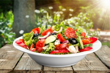 Photo of fresh salad with vegetables