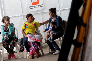 Women wait for medical attention at a shelter for Venezuelan migrants in Cucuta