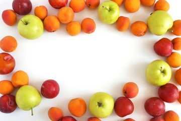 Plum, apples and apricots isolated on white background. Creative flat layout of fruit, top view.