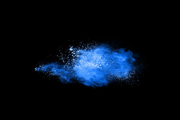 Blue powder explosion on black background. Colored cloud. Colorful dust explode. Paint Holi.