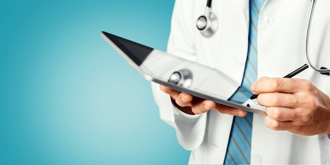 Close-up Doctor at hospital working with tablet