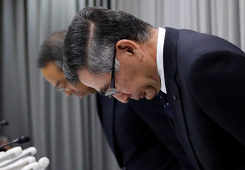 Suzuki Motor CEO Suzuki bows with other anexecutive during a news conference in Tokyo