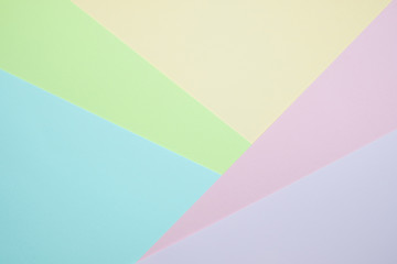 Fashionable  pastel colored paper flat lay top view, geometric background texture, pink, purple,...