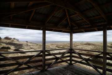 Wooden observation deck with a beautiful view of the dunes of the Curonian spit