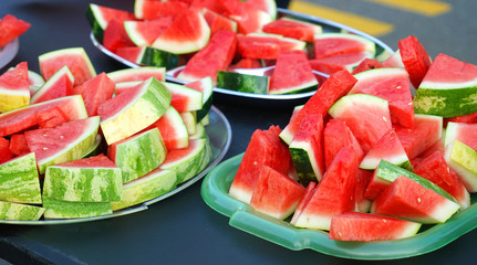 watermelon cut in pieces in the container for the event