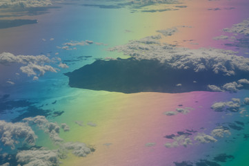 Island in the north of the Aegean sea saw from an airplane. Colors produced when light is passed through the airplane window.