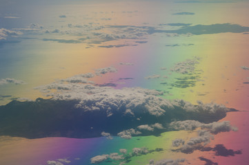 Islands in the north of the Aegean sea saw from an airplane. Colors produced when light is passed through the airplane window.