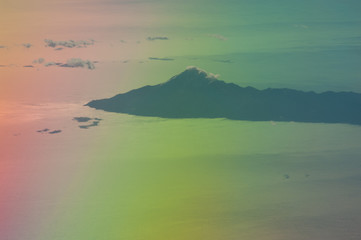 Peninsula in the north of the Aegean sea saw from a plane. Greece. Colors produced when light is passed through the plane window.