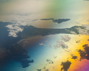 North of the Aegean sea saw from an airplane. Greece. Colors produced when light is passed through the airplane window.