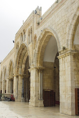 The arched stone wall entrance to the Al Aqsa Mosque on the ancient Temple mount in Jerusalem Israel
