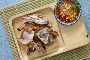 Grilled dried squid and spicy sweet sauce in white dish