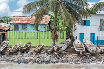 Sao Tome, dugouts on the beach in fishermen's village, typical houses