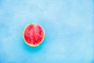 cut fresh watermelon on wooden table. Above view