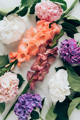 top view of background with colorful hortensia and gladioluses flowers on marble surface