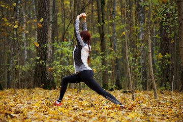 Photo of sporty fitness girl doing stretching exercises in fresh air