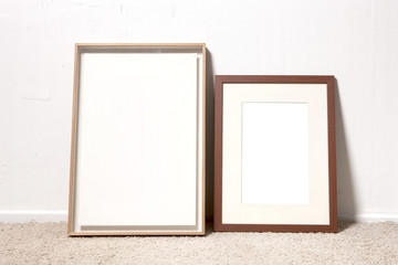 empty white photo frames