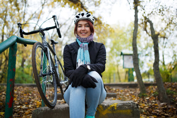 Image of girl sitting on stairs next to bicycle