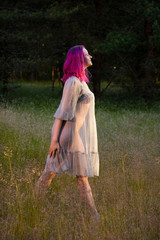 Beautiful young seminude woman in blue transparent dress