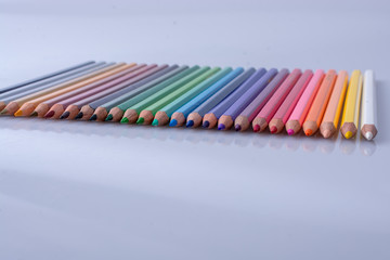 Color Pencils placed on a white background