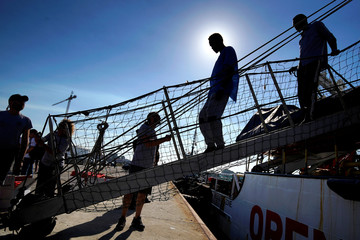 Migrants rescued by NGO Proactiva Open Arms rescue boat in central Mediterranean Sea arrive at the port of Algeciras in San Roque